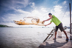 Throwing fishing net. A fisherman throwing a fishing net stock photos
