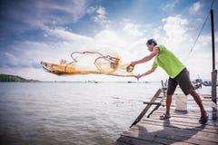 Throwing fishing net Stock Photos