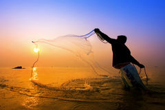 Throwing fishing net royalty free stock photography