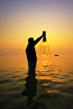Throwing fishing net during sunset. Thailand royalty free stock photography