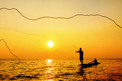 Throwing fishing net Royalty Free Stock Photo