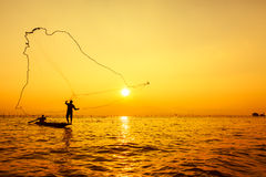 Throwing fishing net Stock Image