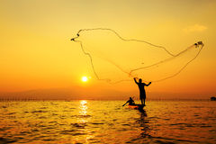 Throwing fishing net Stock Photos