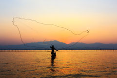 Throwing fishing net Stock Photo