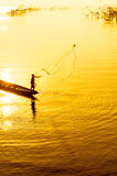 Throwing fishing net Stock Photography