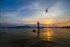 Throwing fishing sunset. Man throwing fishing in thailand Stock Photo