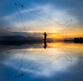 Throwing fishing at sunset silhouette Royalty Free Stock Images