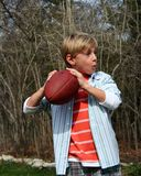 Throwing the Football. Young cute boy throwing the football royalty free stock image
