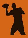 Throwing football. Silhouette of a muscular man throwing a football Stock Photos