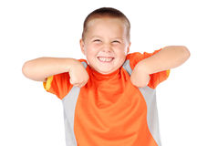 Throwing a funny fit. Small boy misbehaving and loving it Royalty Free Stock Image