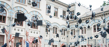 Throwing graduation hats Royalty Free Stock Photo