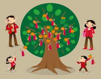 Throwing joss paper onto the Wishing Tree and make wishes. People throw joss paper onto the Wishing Tree and make wishes. It has been one of  the favourite Stock Image