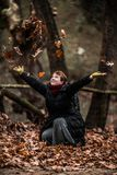 Throwing Leaves in the Air... Woman with Positive Energy Enjoyin Royalty Free Stock Photo