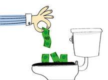 Throwing Money Down the Toilet Royalty Free Stock Images