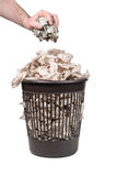Throwing money in the trash can Royalty Free Stock Image