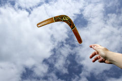 Throwing painted boomerang, midair Stock Photo