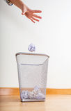 Throwing of paper ball by hand Stock Photo