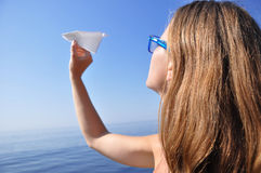 Throwing a paper plane Royalty Free Stock Photo