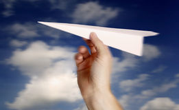 Throwing a paper plane.. Royalty Free Stock Photo