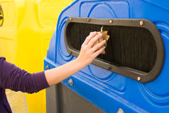 Throwing a paper recycling container Stock Image