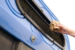 Throwing a paper recycling container Royalty Free Stock Images