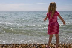 Throwing pebbles in the sea Royalty Free Stock Photo