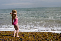 Throwing pebbles into the sea Royalty Free Stock Images