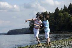 Throwing rocks Royalty Free Stock Photos