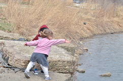 Throwing rocks 2 Royalty Free Stock Photo