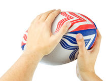Throwing rugby ball Stock Photo