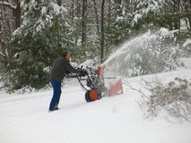 Throwing Snow on Steep Driveway Royalty Free Stock Photos