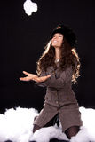 Throwing a snowball. Woman with a Russian fur hat throwing a snowball Stock Images