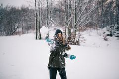 Throwing snowball Stock Photo