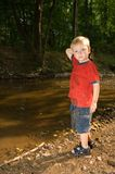 Throwing stones. Boy throwing stones in the water Stock Images