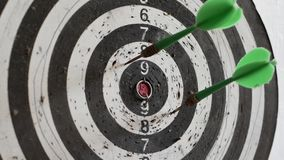 Throwing three darts into the target aim and missing a ten points circle