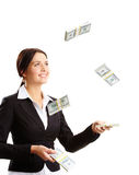 Throwing up dollar bills Stock Photo
