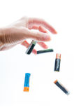 Throwing used batteries Stock Photography