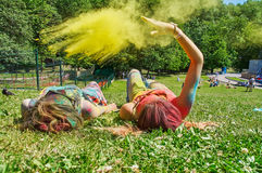 Throwing yellow holi Royalty Free Stock Image