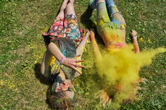Throwing yellow holi Stock Images