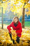 Throwing Yellow Leaves Stock Photos