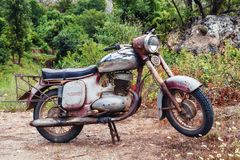 The thrown old rusty brown vintage motorcycle stock photo