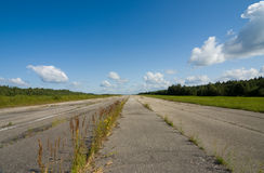 The thrown airdrome. The grass grows on a runway of the thrown airdrome Royalty Free Stock Photo