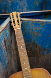 Thrown Away Old Guitar and Dumpster Stock Photos