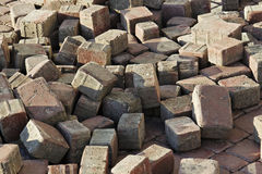 Thrown beige pavement blocks Royalty Free Stock Photos