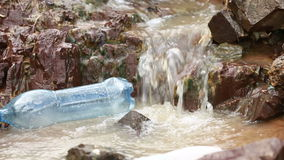 The thrown bottle floats in the river stock video