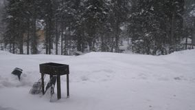 Thrown brazier, bbq costs in the spring forest.Lightly falling snow on a cold winter day. Thrown brazier, bbq costs in the spring forest.Lightly falling snow on Royalty Free Stock Images