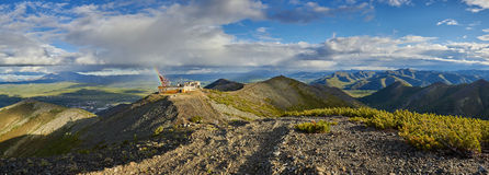Thrown communication station. Evening. After a rain. Thrown communication station Rostelecom. Evening. After a rain. Susuman. The Magadan area. Kolyma Stock Photo