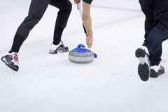 Thrown Curling Stone Stock Photo
