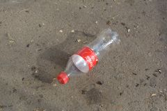 The thrown empty bottle of a Coca Cola Royalty Free Stock Photos