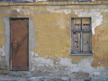 The thrown old house. The window and a door are closed. A shabby structure Stock Photography